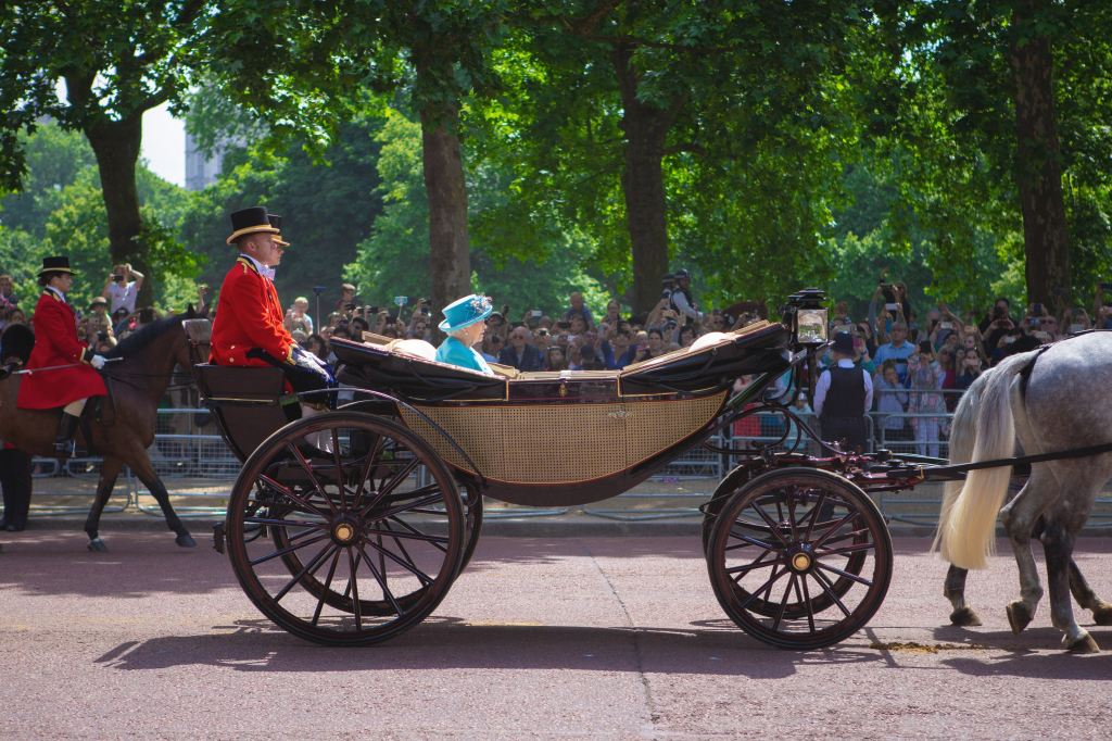 Picture of Queen Elizabeth in open carriage in London. Credit: Mark-de-jong at unsplash.com